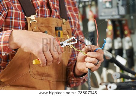 hands of electrician builder engineer worker with electric equipment and wire