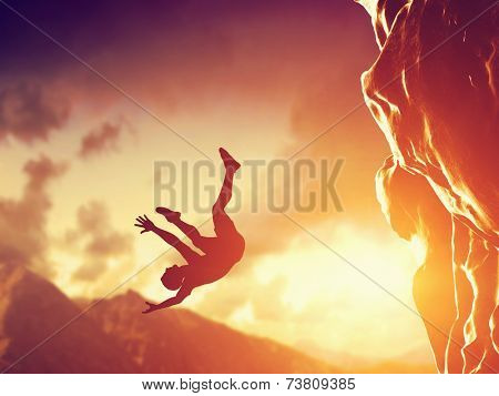 Hiker free falling from the mountain, cliff. Concept of man in dangerous or fatal situation, accident.