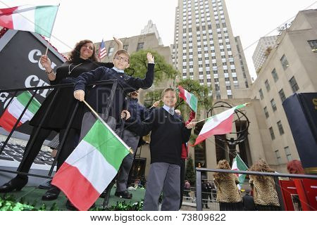 Float riders with Italian flags