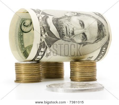 Five Dollar Bill Over Stack Of Coins