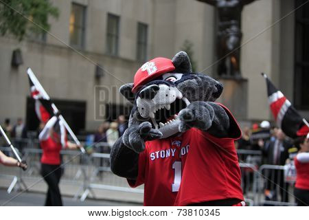 Sports mascot poses in front of Rockefeller Center