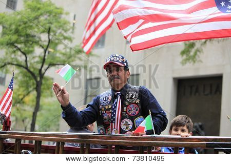 Decorated FDNY member on float