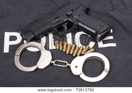 Security Concept With Gun Ammo And Handcuffs