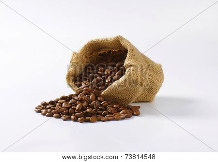 portion of roasted coffee in the burlap bag