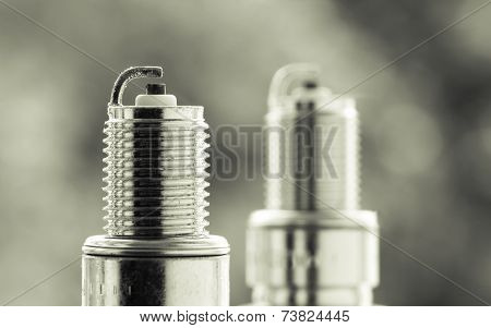 Auto Service. Two New Spark Plugs As Spare Part Of Car.