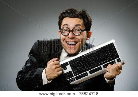 Comouter geek with computer keyboard