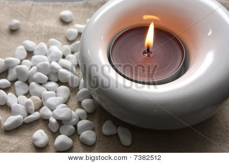 Candles And Massage Stones In A Calm Zen Spa