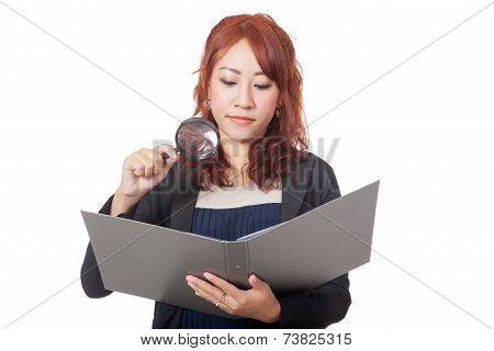 Asian Office Girl Use Magnifying Glass Check On A Folder With Bad Mood