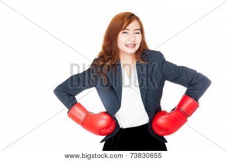 Asian Businesswoman Arms Akimbo With Boxing Glove