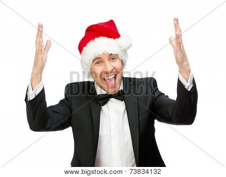 Half-length portrait of businessman wearing Santa Claus cap with hands up, isolated on white. Concept of holidays and Christmas