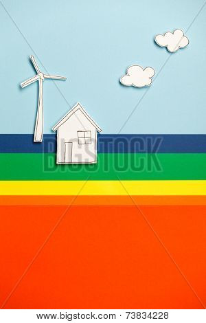 House model, windmill and clouds on colorful background. Concept of peace and earth