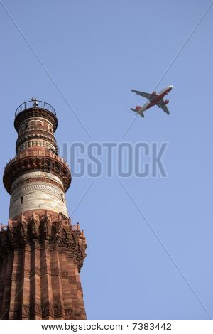 Qutb Minar Tower And A Plane, Delhi, India