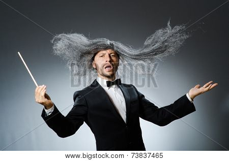 Funny conductor with long grey hair