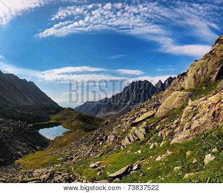 Cirrus Clouds Over The Mountain Tundra