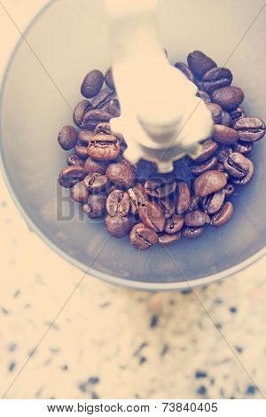 manual coffee grinder with coffee beans, instagram filter or retro filter effect