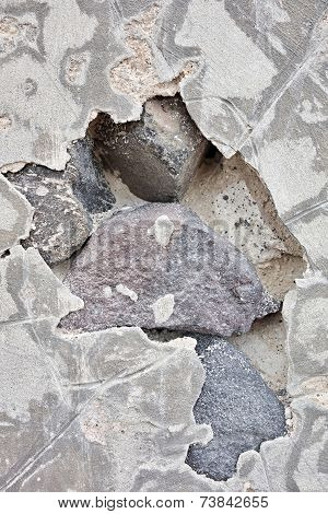 Abstract Hole In Cement On A Stone Wall
