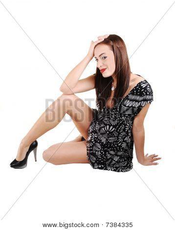Young Girl Sitting On Floor.
