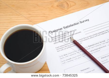 Customer Service Satisfaction Survey Form And Cup Of Coffee