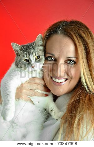 Portrait Of Pretty Woman Hugging Her Cat