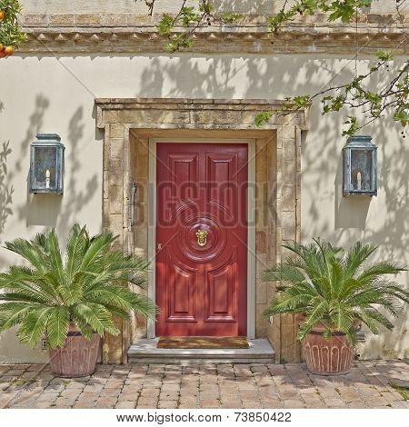 red door and flowerpots Athens Greece