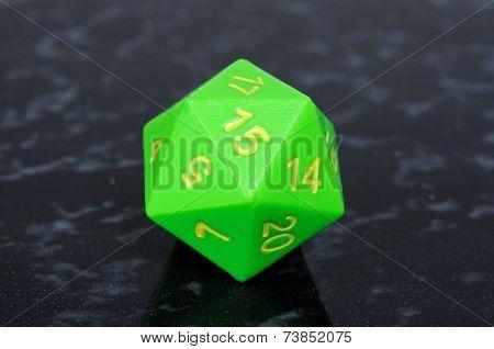 Green icosahedron die.