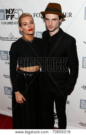 NEW YORK-OCT 10: Actress Sienna Miller (L) and Tom Sturridge attend the