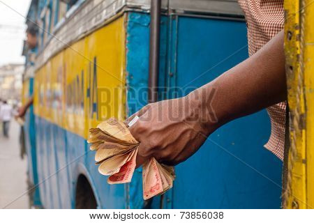 Man holding Indian rupee notes