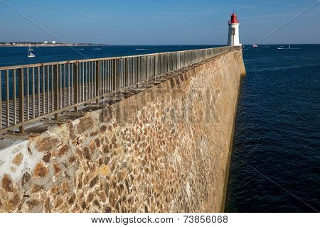 Pier and beacon in Sables d'Olonnes, France