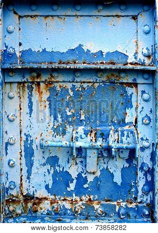 Massive Iron Door With Peeling Blue Paint