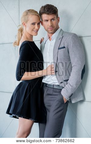 Sweet Young Caucasian Couple Fashion Shoot Isolated on Light Gray Wall Background