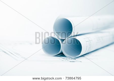 project plan background with blueprints rolls