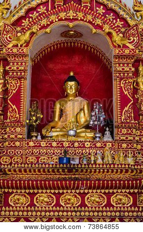 Gold Bhudda On The Wall