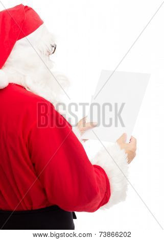 christmas, holidays and people concept - man in costume of santa claus reading letter