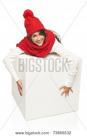 Winter woman hugging big white box