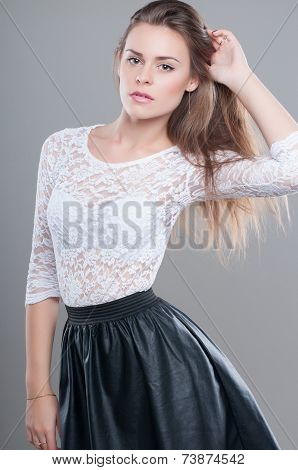 sexy fashion woman in black leather skirt