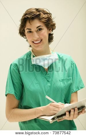 Female doctor taking notes