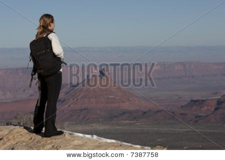 Female Hiker Looking Out Over A Canyon