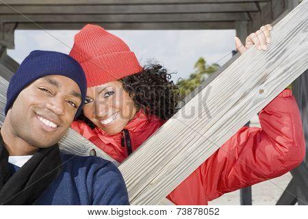 Multi-ethnic couple wearing winter clothing