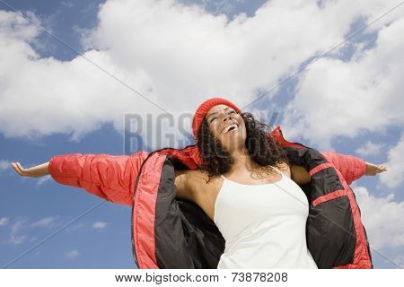 Hispanic woman with arms outstretched