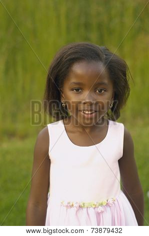 Young African girl smiling outdoors