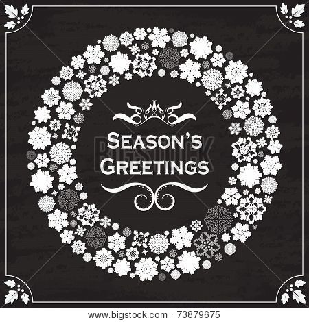 Vintage style season's greetings on chalkboard