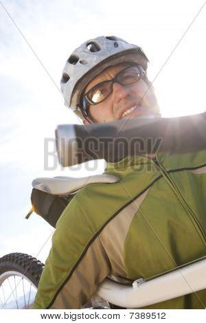 Young Man Carrying A Mountain Bike