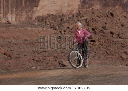 Elderly Woman Smiling On A Bike