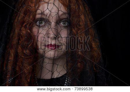 Woman in with black veil