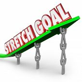 picture of objectives  - Stretch Goal words on an arrow lifted by a team of workers to illustrate long - JPG