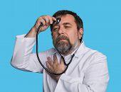 stock photo of madman  - Humorous concept of health - JPG