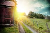 foto of farm landscape  - Summer landscape with old barn and country road at sunset - JPG