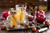 stock photo of cider apples  - Apple cider drink with cinnamon and anise in two glasses