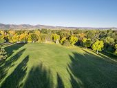 image of collins  - aerial view of park in fall colors under morning light with deep long shadows - JPG