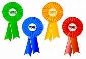 stock photo of rosettes  - 4 different coloured political rosettes over a white background - JPG